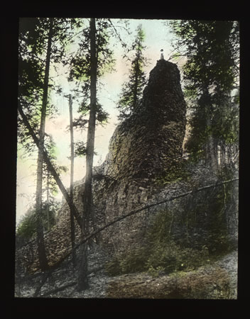 Woman on top of Basalt/Frank Palmer, Photographs, Spokane City Parks, Lantern Slides, 1900-1930, Washington State Archives, Digital Archives.